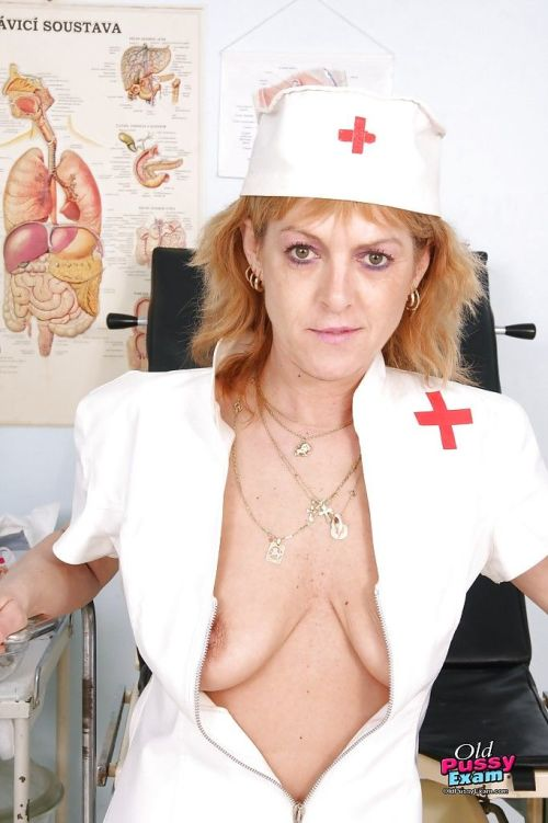 Slim mature lady in nurse uniform uncovering her tits and pink twat
