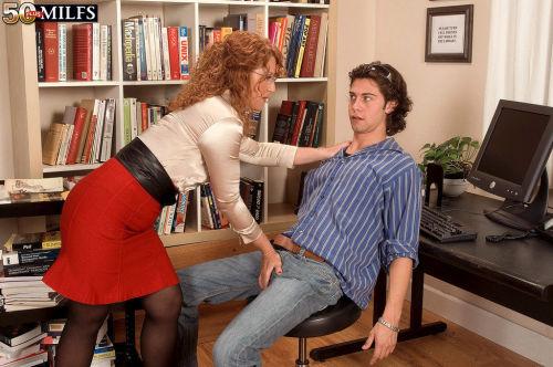 Mature redhead librarian Demi La Rue seduces a student among book stacks