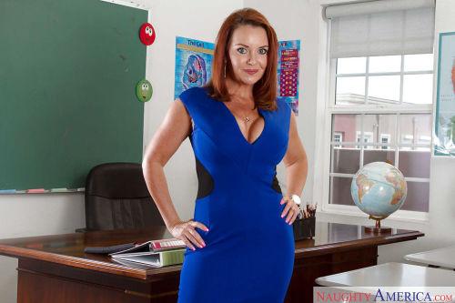 Curvy redhead teacher Janet Mason flashes mature legs in classroom