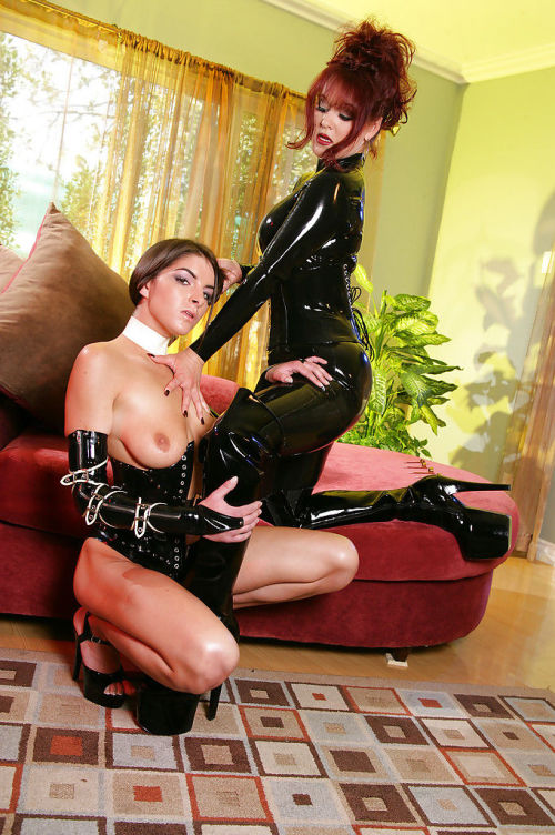 Naughty BDSM lezdom action with latex attired lesbians using whips and toys
