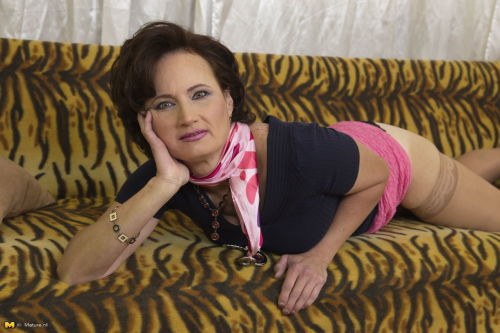 Older dame in pink skirt flashes upskirt panties and some stocking tops - part 2